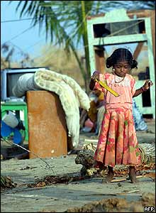 Little girl in Kallar, southern India, plays in a courtyard