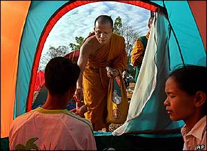 Buddhist monks distribute aid