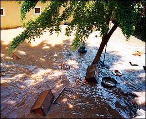 Flood waters swirling around debris