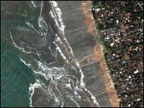 The water pulls back to the sea exposing 300 metres of beach which had been covered by the ocean. (Photo: DigitalGlobe)