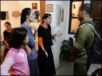Israeli soldier arrives at a settlers' home