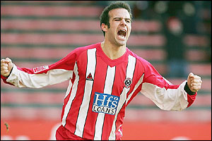 Andy Liddell celebrates scoring twice for Championship side, Sheffield United