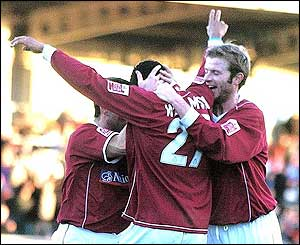 Lee Williamson celebrates as he equalises for Northampton from 25 yards out