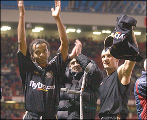 Exeter City players Les Afful and Sean Devine celebrate