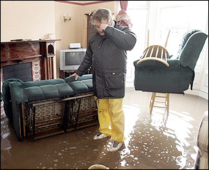 Ian Curry examines the flood damage to his Warwick Road home