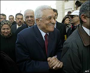 Palestinian presidential candidate Mahmoud Abbas, followed by his wife Amina (left) leaves the Muqataa polling station in Ramallah