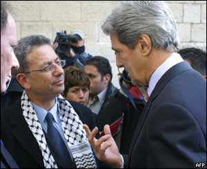 Candidate Mustafa Barghouti and former US presidential candidate John Kerry outside a polling station in Ramallah