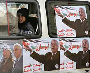 Palestinians boy looks from a vehicle covered with campaign posters of presidential candidate Mahmoud Abbas,  Abu Dis, West Bank