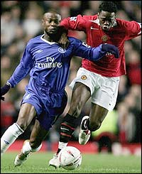 Chelsea's William Gallas battles for the ball with Louis Saha