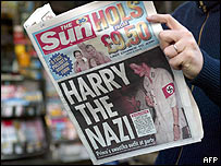 Newspaper with Prince Harry on the front page