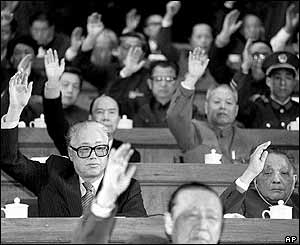 Chinese Communist Party General Secretary Zhao Ziyang (left in 2nd row) and Chinese leader Deng Xiaoping (right in 2nd row) vote at the start of the National People's Congress in Beijing, March 1988