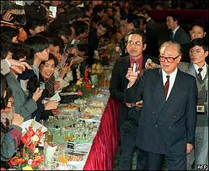 Zhao Ziyang (rights) greets foreign journalists who were allowed to cover the 13th Communist Party Congress at the People's Great Hall in Beijing, November 1987
