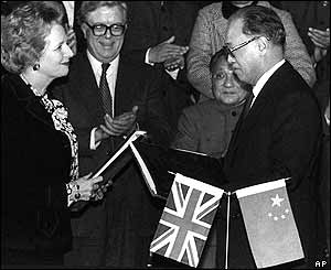 UK Prime Minister Margaret Thatcher (left) and Chinese Premier Zhao Ziyang (right) exchange signed copies of the Hong Kong handover agreement to China, Beijing, 19 December 1984