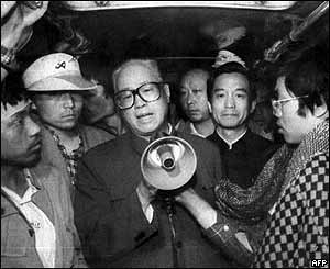 Zhao Ziyang (centre) addresses the student hunger strikers through a megaphone, 19 May 1989, in a bus in Tiananmen Square in Beijing. To his right is current Premier Wen Jiabao.