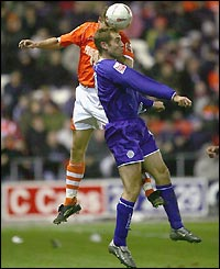 James Scowcroft looks to score Leicester's second as they struggle at a windy Bloomfield Road