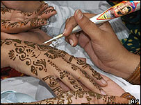 Girls having their hands painted for Eid celebrations