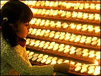 Girl lighting a candle