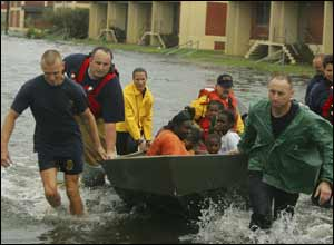 Rescuers save a family from the high waters in Mobile