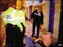 Police dealing with a drunk young person (library)
