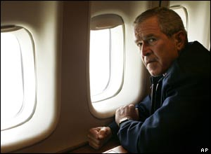 President Bush looks out from his personal plane, Airforce One, over the devastation