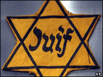 A yellow Star of David badge used to identify Jewish prisoners in Nazi concentration camps