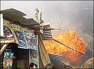 Fire rips through a religious goods stall in the temple complex