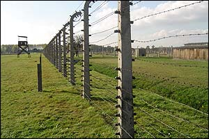 The watch towers and perimeter fence surrounding Birkenau, the largest of all the Nazi extermination camps.