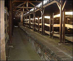 Inside the barracks, the three-tiered bunks where thousands of prisoners were packed in.