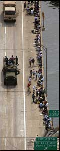 Evacuees in New Orleans wait to be taken out of the stricken city