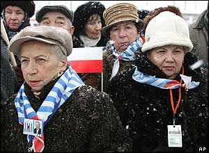 Survivors of the Auschwitz death camp, wearing scarves in the colours of the Israeli flag
