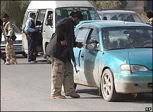 Iraqi soldiers inspect cars in Basra, southern Iraq