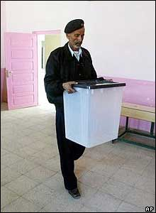 An Iraqi policeman delivers ballot boxes to a polling station in central Zubair, southern Iraq