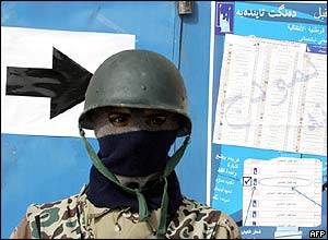 An Iraqi soldier at a polling station in the Baghdad district of Sadr City