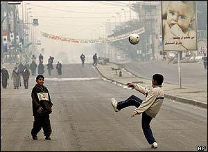 Boys play on the street in Baghdad