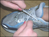 Helping to tie shoelaces