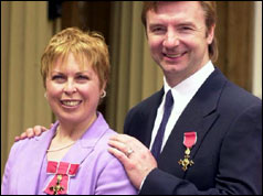 Torvill and Dean in 1999 with their OBEs