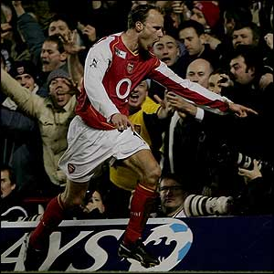 Dennis Bergkamp celebrates putting Arsenal 2-1 up