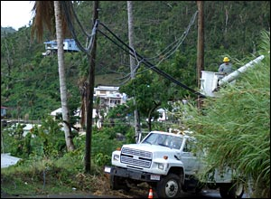 Cuban electricity engineers work on restoring electricity pylons in Grenada