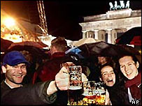 Germans celebrating the fall of the Berlin Wall