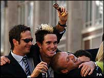 Michael Vaughan, Andrew Flintoff and Kevin Pietersen on the victory bus