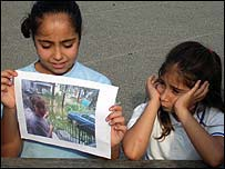 Ariane with her sister Talia, and a photo of the floods outside their home