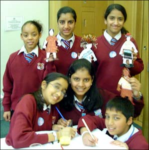 These school children are cutting out paper figures, or buddies, during the launch of The Send My Friend to School Campaign in London.