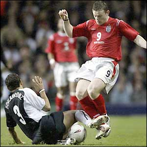 Wayne Rooney is tackled by Khalid Boulahrouz