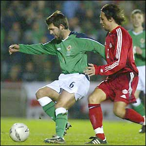 Tommy Doherty tries to find a way through for Northern Ireland