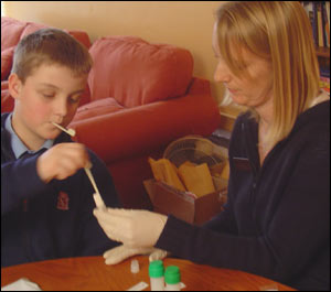 After two minutes he can remove the swabs which look like plastic cotton buds.