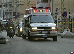 Ambulance carrying the body of Rafik Hariri through the streets of Beirut
