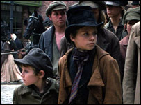 Little orphan Oliver (Barney Clark) is looked after by the Artful Dodger (Harry  Eden)
