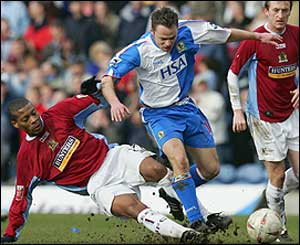 Micah Hyde of Burnley and Paul Dickov of Blackburn Rovers