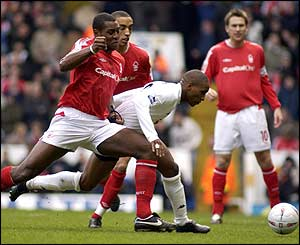 Nottingham Forest's Wes Morgan and Tottenham's Jermain Defoe