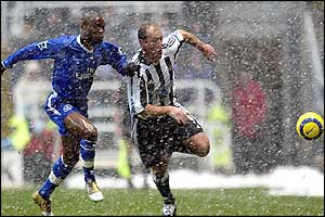 Chelsea's William Gallas races Alan Shearer of Newcastle